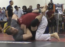 Alex Embry, left, performing a choke (martial arts technique)